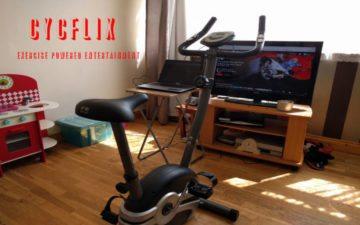 Imagem de uma bicicleta estática ligada à uma série de fios, com a Netflix. Cycflix