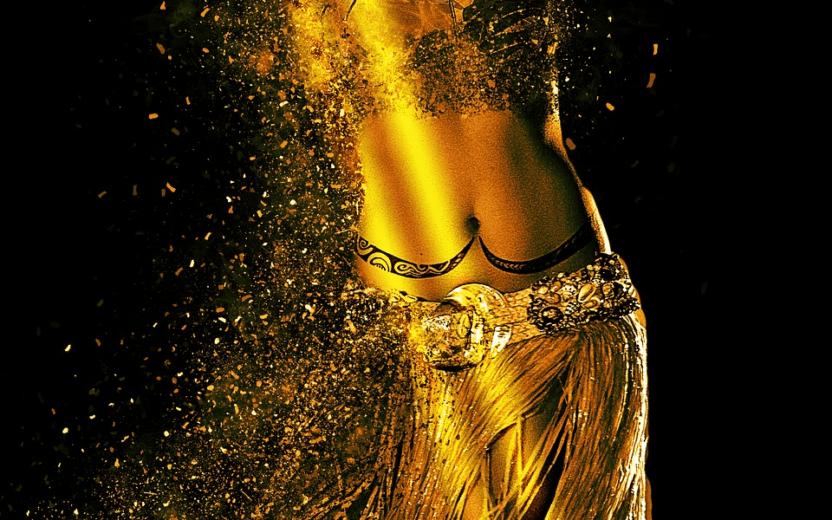 Imagem com fundo preto e corpo todo dourado, com roupas de dança do ventre