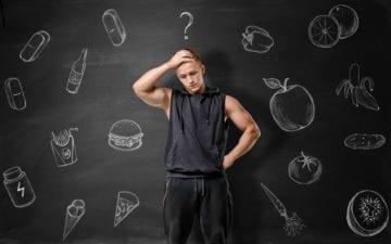 Homem com mão na cabeça, nervoso. Ao fundo, desenhos de alimentos que podem prejudicar a saúde, o deixam indeciso sobre o que consumir
